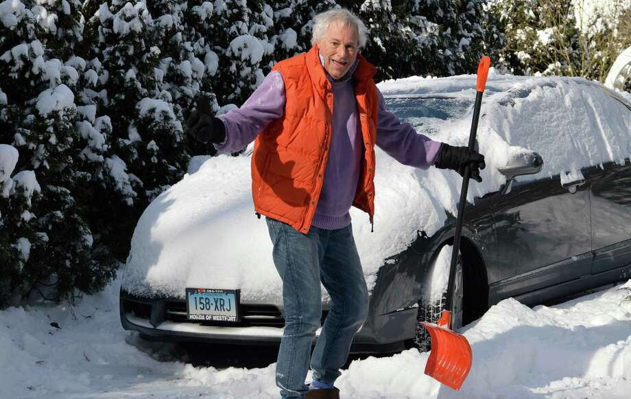 Hey, it's winter! Peter Bonds was nonchalant about the seasonal snowfall Friday in Westport. Photo: Jarret Liotta / Westport News contributed