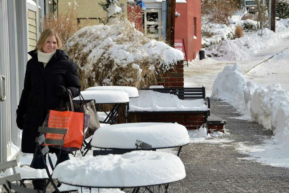 Jennifer Guy grabs a coffee before opening Calypso for a limited noon to 4 p.m. business day because of the storm Friday in Westport. Photo: Jarret Liotta / Westport News contributed