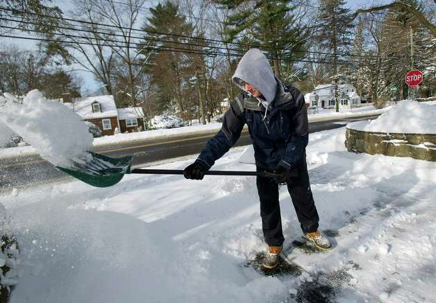 Jack O'Connor, 15, shovels snow on Pepper Ridge Road in Stamford, Conn., on Friday, January 3, 2014. Photo: Lindsay Perry / Stamford Advocate