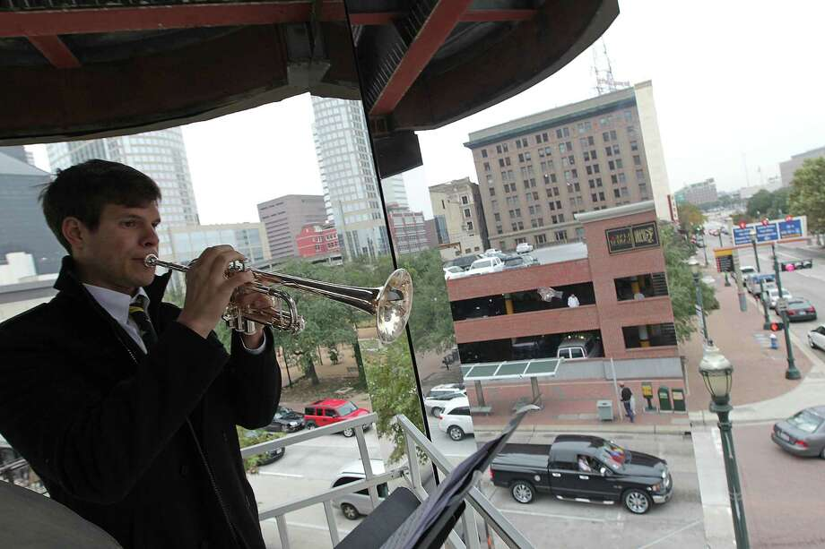 Russell Haehl plays a trumpet solo during a brass concert at the Market Square Clock Tower. Photo: James Nielsen, Staff / © 2013  Houston Chronicle