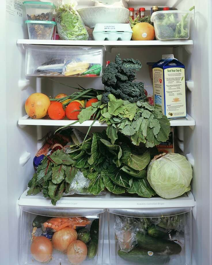 Mark Menjivar peeks into refrigerators. Photo: Mark Menjivar / ONLINE_YES
