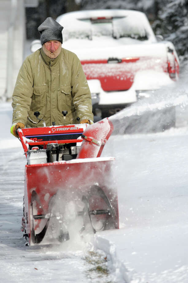 Stanley Milas plows snow from his driveway on Peters Lane following an overnight snowfall in Stratford, Conn., Jan. 3, 2014. Photo: Ned Gerard / Connecticut Post