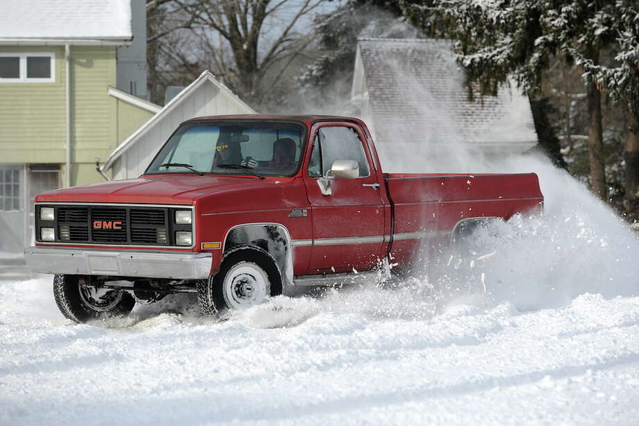 A pickup truck spins donuts in the parking lot at Boothe Memorial Park following an overnight snowfall in Stratford, Conn., Jan. 3, 2014. Photo: Ned Gerard / Connecticut Post