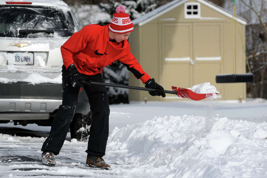 Brett Cody shovels snow from his driveway on Edison Street following an overnight snowfall in Stratford, Conn., Jan. 3, 2014. Photo: Ned Gerard / Connecticut Post