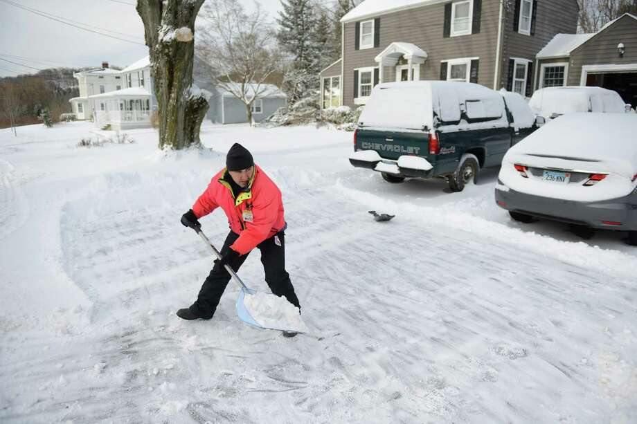 Mark Forlenzo shovels the driveway of his home in Newtown, Conn. on Friday, Jan. 3, 2014.  Snowfall across the state ranged from 4 inches in Oxford to 9.5 inches in Milford and Darien with temperatures in the single digits and wind chill well below zero. Photo: Tyler Sizemore / The News-Times