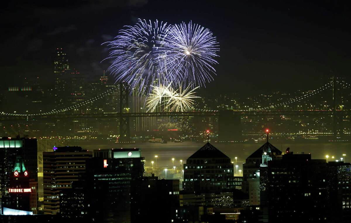 Fireworks fill the air in the bay.