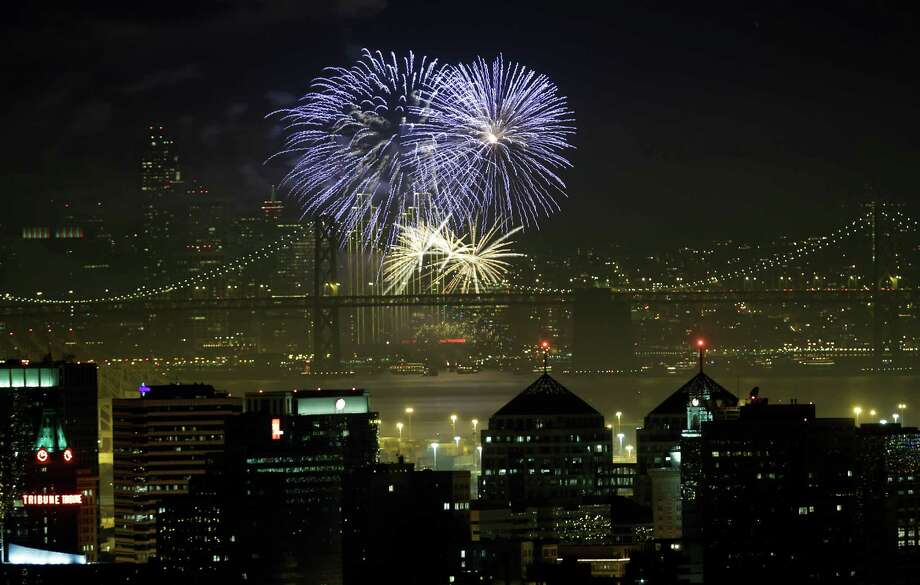 Fireworks fill the air in the bay. Photo: Marcio Jose Sanchez / Associated Press / AP