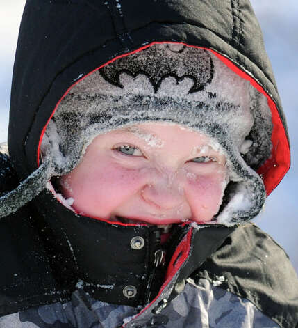 Will Dammon, 7, of Greenwich, got a frosting of snow after wiping-out while sled riding at the Western Greeenwich Civic Center, Greenwich, Conn., Friday afternnon, Jan. 3, 2014, during the aftermath of the snow storm that hit the area. Photo: Bob Luckey / Greenwich Time