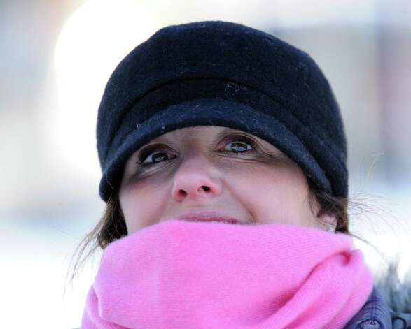 Karen Hirsh of Greenwich watches the sled riders at the Western Greeenwich Civic Center, Greenwich, Conn., Friday afternnon, Jan. 3, 2014, during the aftermath of the snow storm that hit the area. Photo: Bob Luckey / Greenwich Time