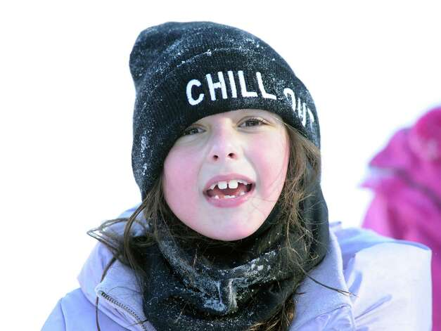 """""""I froze my teeth,"""" was the reply of Avery Hirsh, 7, of Greenwich, when asked about the cold weather while sled riding at the Western Greeenwich Civic Center, Greenwich, Conn., Friday afternnon, Jan. 3, 2014, during the aftermath of the snow storm that hit the area. Photo: Bob Luckey / Greenwich Time"""