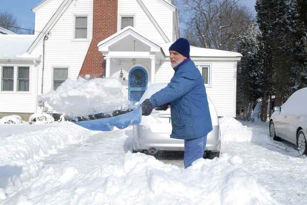 Kevin Masciarelli digs out his driveway on Bradley Place in Stamford, Conn.   in the bitter cold on Friday January 3, 2013. Photo: Dru Nadler / Stamford Advocate Freelance