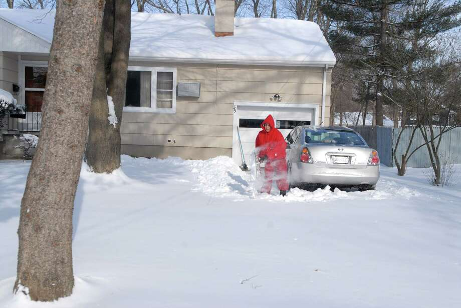 Charan Channa shovels her driveway in Stamford, Conn. on Friday January 3, 2013. Photo: Dru Nadler / Stamford Advocate Freelance