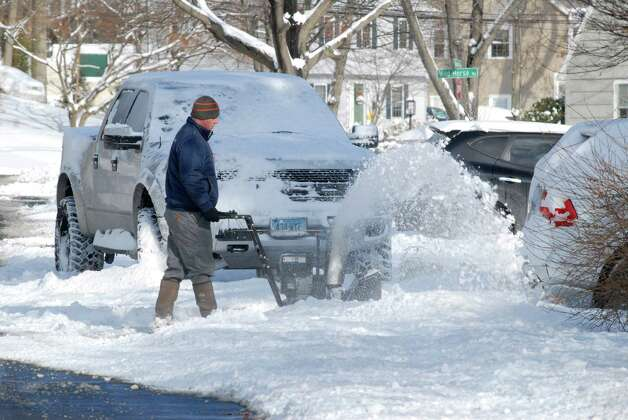 Rob Padula clears his driveway in Stamford, Conn. after the snowstorm on Friday January 3, 2013. Photo: Dru Nadler / Stamford Advocate Freelance