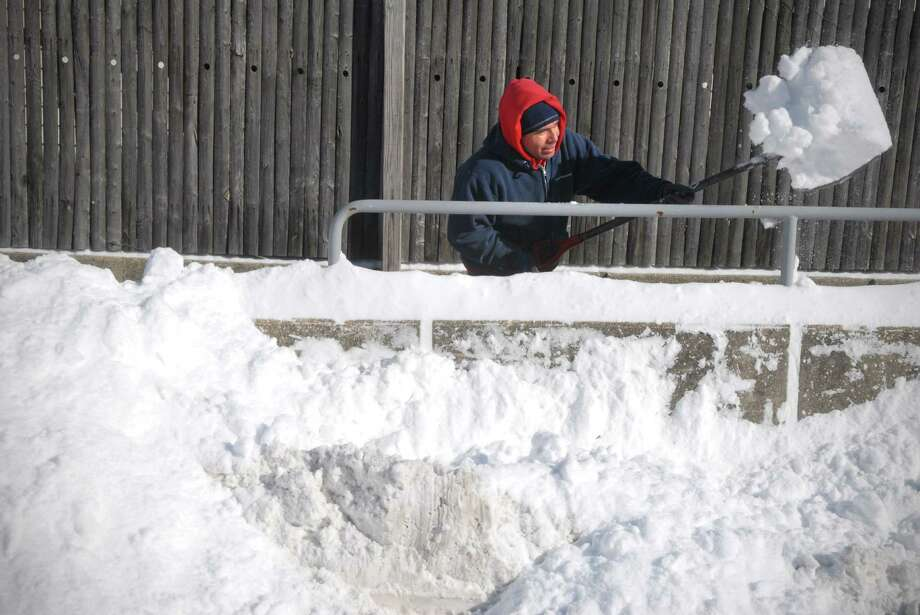 Leon Rodriguez digs out a path on Oak St in Stamford, Conn. on Friday January 3, 2013. Photo: Dru Nadler / Stamford Advocate Freelance