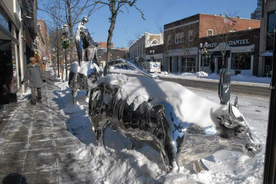A woman walks down Bedford St in downtown Stamford, Conn.after the snowstorm on Friday January 3, 2013. Photo: Dru Nadler / Stamford Advocate Freelance