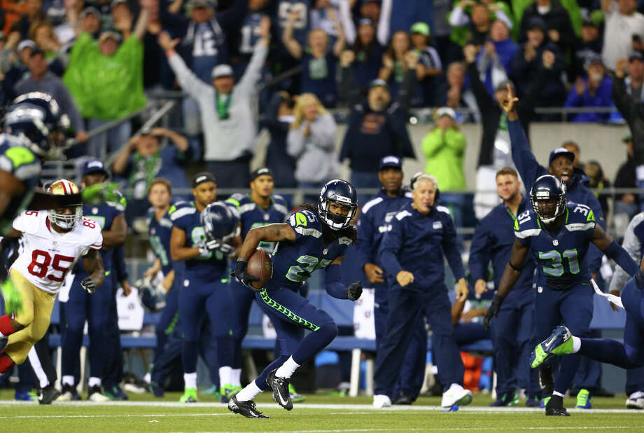 Seattle Seahawks player Richard Sherman returns an interception against the San Francisco 49ers. Photographed on Sunday, September 15, 2013 at CenturyLink Field in Seattle. Photo: JOSHUA TRUJILLO, SEATTLEPI.COM / SEATTLEPI.COM