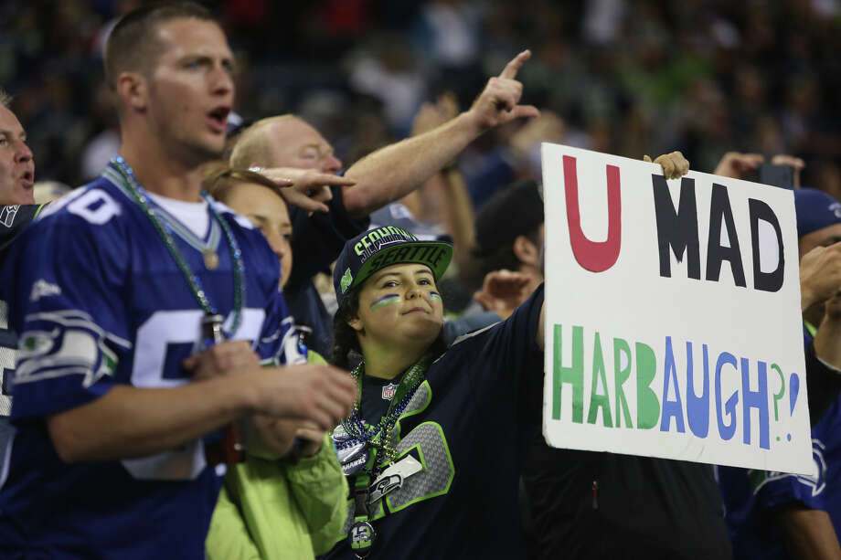A Seattle Seahawks fan holds up a sign referencing San Francisco 49ers coach Jim Harbaugh. Photographed on Sunday, September 15, 2013 at CenturyLink Field in Seattle. Photo: JOSHUA TRUJILLO, SEATTLEPI.COM / SEATTLEPI.COM
