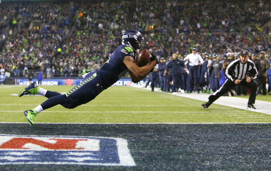 Seahawks player Jermaine Kearse pulls down a catch in the end zone against the Saints during an NFL game on Monday, Dec. 2, 2013, at CenturyLink Field in Seattle. Flags were thrown on the play and it was not ruled a touchdown. Photo: JOSHUA TRUJILLO, SEATTLEPI.COM / SEATTLEPI.COM