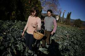 Hailey Trefethen (l to r) carries a basket of broccoli she and brother Lorenzo Trefethen, who are  taking over their family winery, picked from La Huerta (the one acre family vegetable garden) at Trefethen Family Vineyards on Thursday, December 19, 2013  in Napa, Calif.