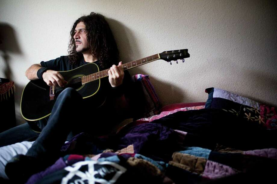 Marzi Montazeri 's family immigrated to the U.S. from Iran when he was 9. He didn't speak English and found the guitar to be an equalizer. Photo: Marie D. De Jesus, Staff / © 2013 Houston Chronicle