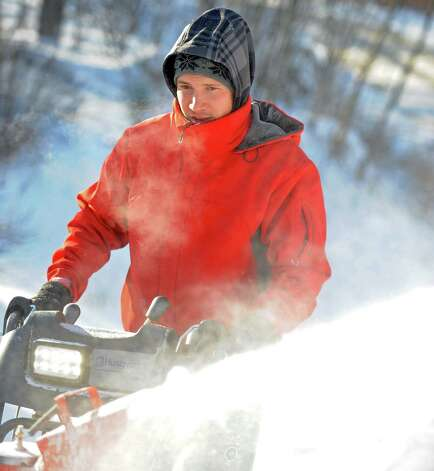 Greg Sczaplicki uses a snowblow