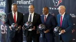 Cal McNair, Houston Texans vice chairman and COO, far left, Bill O'Brien, head coach, Rick Smith, general manager, and Bob McNair, owner, pose for a photo following a news conference introducing O'Brien as the Texans new head coach, at Reliant Stadium on Friday.
