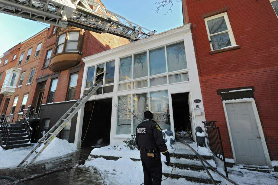 Scene of a fatal fire at at 28 Dove St. on Friday, Jan. 3, 2014 in Albany, N.Y.  A 47-year-old man died of smoke inhalation due to the fire early Friday afternoon, according to a city fire official. (Lori Van Buren / Times Union) Photo: Lori Van Buren