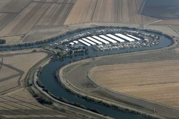 A horseshoe-shaped marina ocupies a bend in a river flowing through the Sacramento-San Joaquin River Delta on Wednesday, Nov. 9, 2011. If built, the Peripheral Canal would divert fresh water to the south and could have a significant impact on the future of the delta, its wildlife and local farming.
