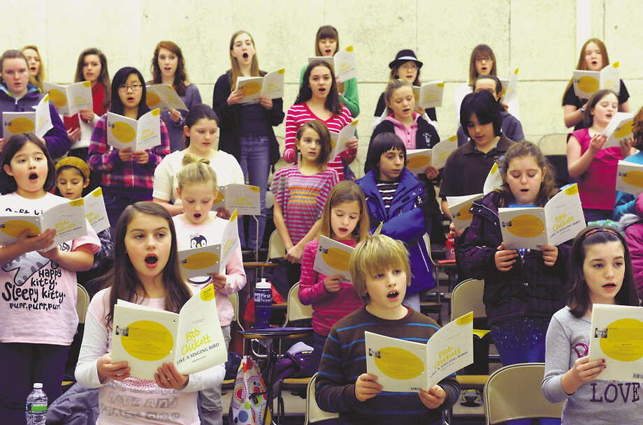 Michael P. Farrell / Times Union Members of the Capital District Youth Chorale practice last February at the Performing Arts building at the University at Albany. The chorale will hold auditions, and its first rehearsal for the spring semester, on Saturday.