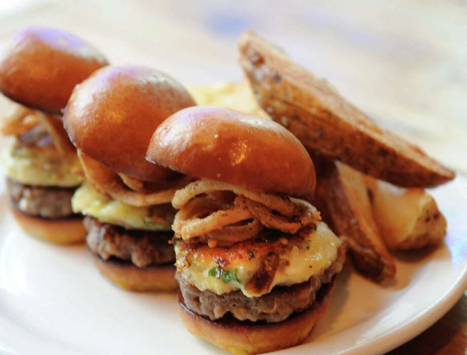 Banger sliders at Finnbar's at 452 Broadway on Thursday, Dec. 26, 2013 in Troy, N.Y. Three house-made sausage patties, mashed potato cakes and fried onions. Served with house-cut chips. (Lori Van Buren / Times Union) Photo: Lori Van Buren / 00025169A