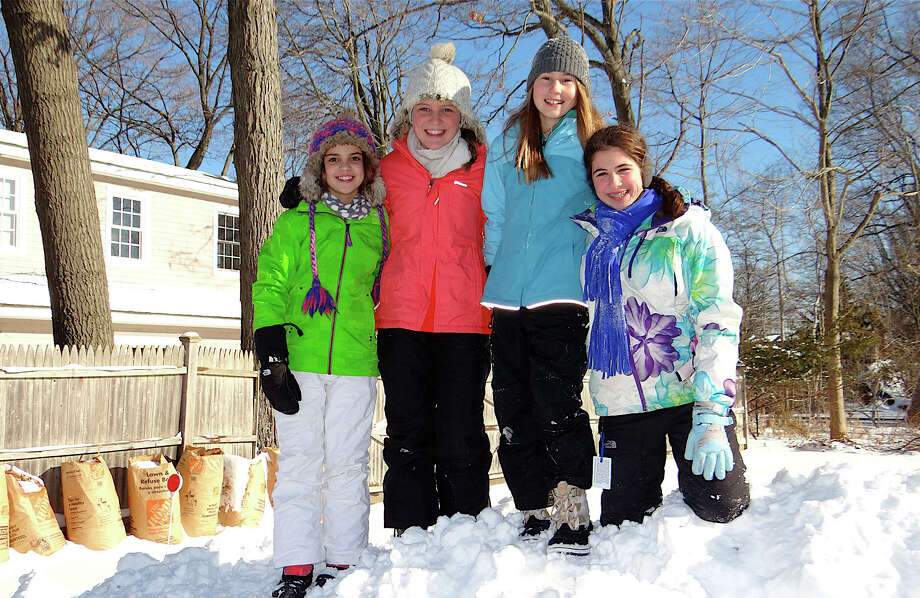 Atop a snow mountain Friday were, from left: Sofia Nikac, 11; Isabel Nikac, 13; Alyssa Kraus, 13, and Madelyn Cagnassola, 13. Photo: Mike Lauterborn / Fairfield Citizen contributed