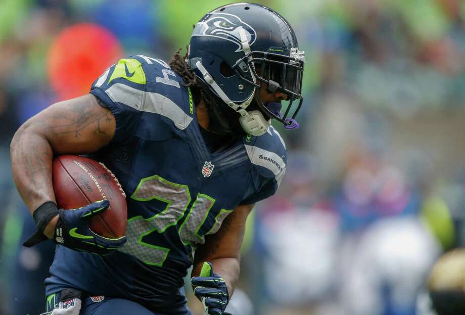 SEATTLE, WA - SEPTEMBER 22:  Running back Marshawn Lynch #24 of the Seattle Seahawks rushes against the Jacksonville Jaguars at CenturyLink Field on September 22, 2013 in Seattle, Washington. Photo: Otto Greule Jr, Getty Images / 2013 Getty Images