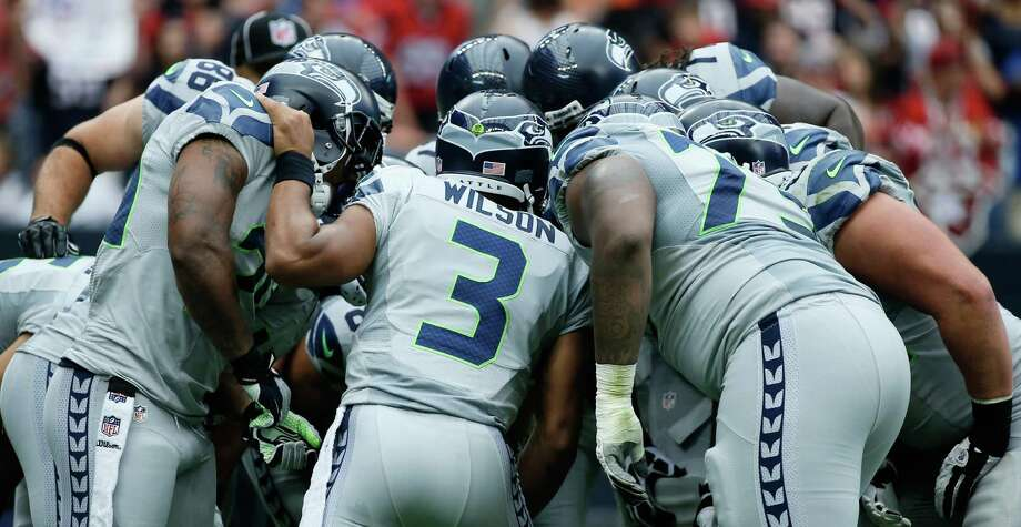 HOUSTON, TX - SEPTEMBER 29:  Russell Wilson #3 of the Seattle Seahawks calls a play in the huddle against the Houston Texans at Reliant Stadium on September 29, 2013 in Houston, Texas. Photo: Scott Halleran, Getty Images / 2013 Getty Images
