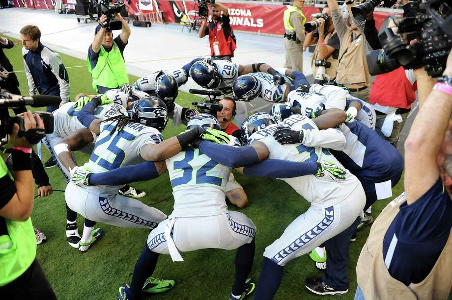 GLENDALE, AZ - OCTOBER 17: Jeron Johnson #32 and teammates of the Seattle Seahawks get ready for a game against the Arizona Cardinals at University of Phoenix Stadium on October 17, 2013 in Glendale, Arizona. Photo: Norm Hall, Getty Images / 2013 Norm Hall