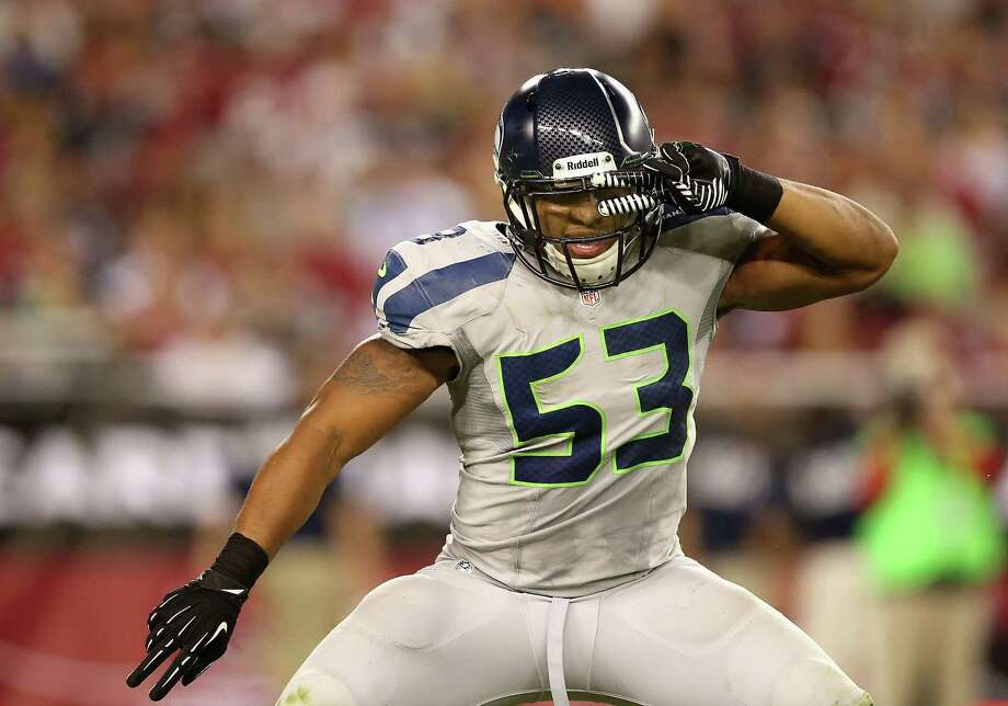 GLENDALE, AZ - OCTOBER 17:  Outside linebacker Malcolm Smith #53 of the Seattle Seahawks celebrates after a sack against the Arizona Cardinals during the NFL game at the University of Phoenix Stadium on October 17, 2013 in Glendale, Arizona.  The Seahawks  defeated the Cardinals 34-22.  (Photo by Christian Petersen/Getty Images) *** Local Caption *** Malcolm Smith Photo: Christian Petersen, Getty Images / 2013 Getty Images