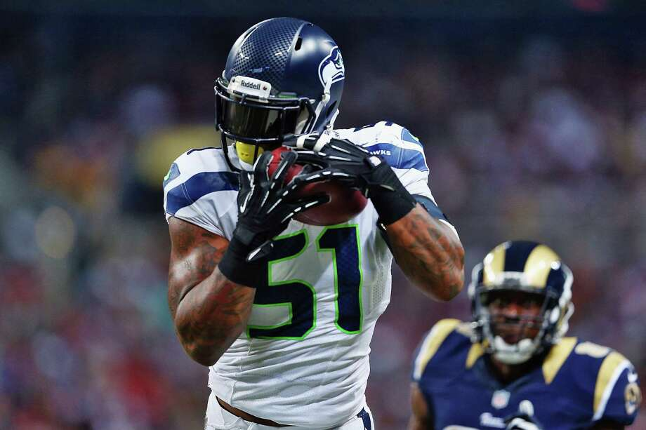ST. LOUIS, MO - OCTOBER 28:  Bruce Irvin #51 of the Seattle Seahawks intercepts Kellen Clemens #10 the St. Louis Rams during an NFL game at Edward Jones Dome on October 28, 2013 in St Louis, Missouri. Photo: Andy Lyons, Getty Images / 2013 Getty Images