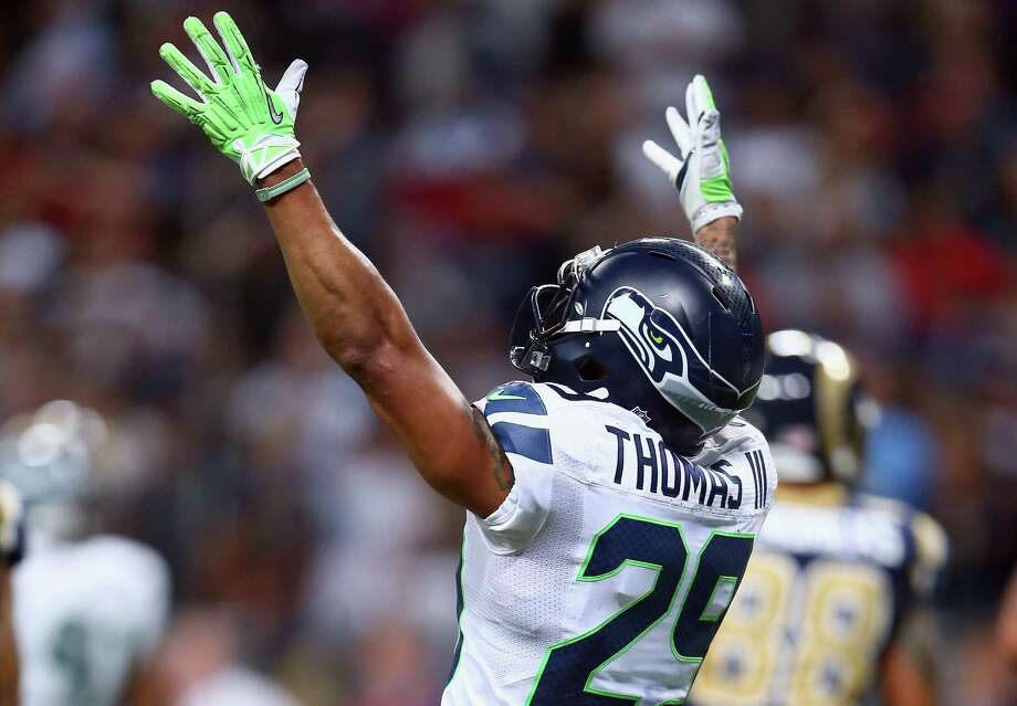 ST LOUIS, MO - OCTOBER 28: Earl Thomas #29 of the Seattle Seahawks celebrates after the 14-9 victory over the the St. Louis Rams at Edward Jones Dome on October 28, 2013 in St Louis, Missouri. Photo: Andy Lyons, Getty Images / 2013 Getty Images