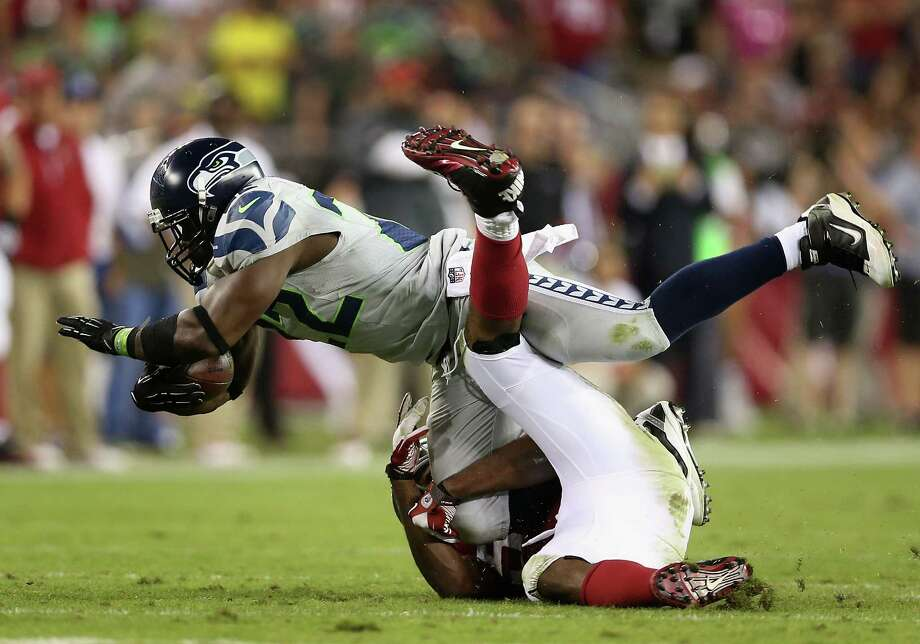 GLENDALE, AZ - OCTOBER 17:  Running back Robert Turbin #22 of the Seattle Seahawks is tacked during the NFL game against the Arizona Cardinals at the University of Phoenix Stadium on October 17, 2013 in Glendale, Arizona.  The Seahawks  defeated the Cardinals 34-22.  (Photo by Christian Petersen/Getty Images) *** Local Caption *** Robert Turbin Photo: Christian Petersen, Getty Images / 2013 Getty Images