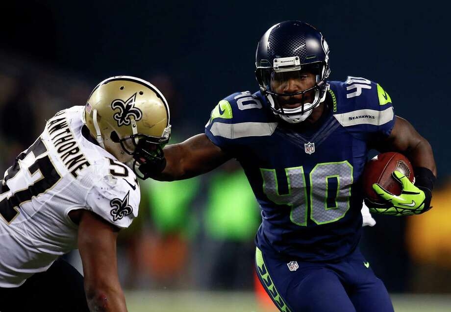 SEATTLE, WA - DECEMBER 02: Fullback Derrick Coleman #40 of the Seattle Seahawks carries the ball as outside linebacker David Hawthorne #57 of the New Orleans Saints defends during a game at CenturyLink Field on December 2, 2013 in Seattle, Washington. Photo: Jonathan Ferrey, Getty Images / 2013 Getty Images
