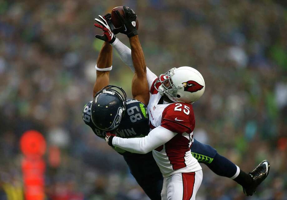 SEATTLE - DECEMBER 22:  Jerraud Powers #25 of the Arizona Cardinals breaks up a passs to Doug Baldwin #89 of the Seattle Seahawks on December 22, 2013 at CenturyLink Field in Seattle, Washington. Photo: Jonathan Ferrey, Getty Images / 2013 Getty Images