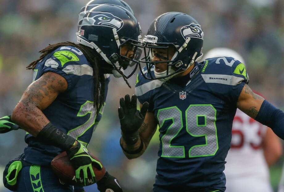 SEATTLE, WA - DECEMBER 22:  Cornerback Richard Sherman #25 of the Seattle Seahawks celebrates with free safety Earl Thomas #29 after making an interception against the Arizona Cardinals at CenturyLink Field on December 22, 2013 in Seattle, Washington. Photo: Otto Greule Jr, Getty Images / 2013 Getty Images