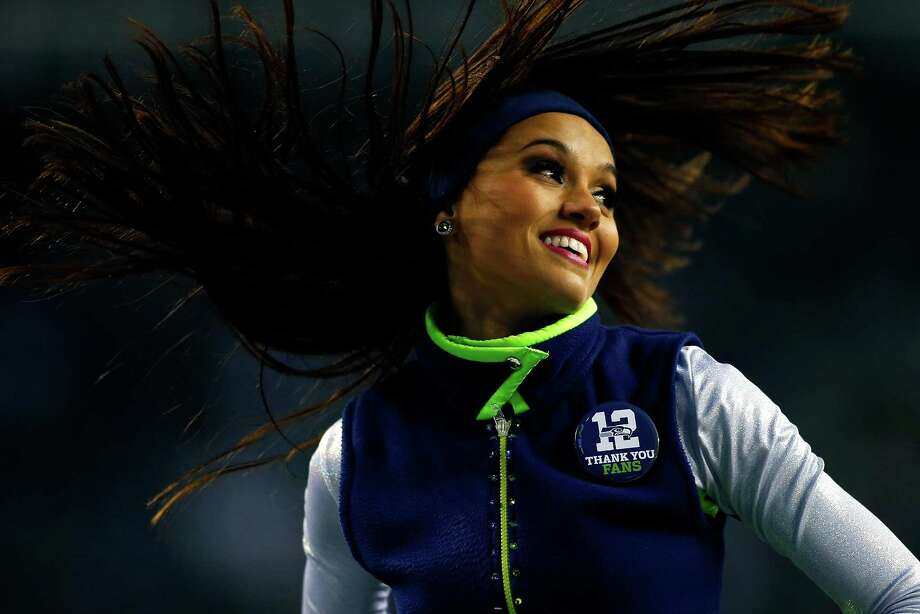 SEATTLE - DECEMBER 29:  A cheerleader performs during a game between the Seattle Seahawks and the St. Louis Rams game on December 29, 2013 at CenturyLink Field in Seattle, Washington. Photo: Jonathan Ferrey, Getty Images / 2013 Jonathan Ferrey