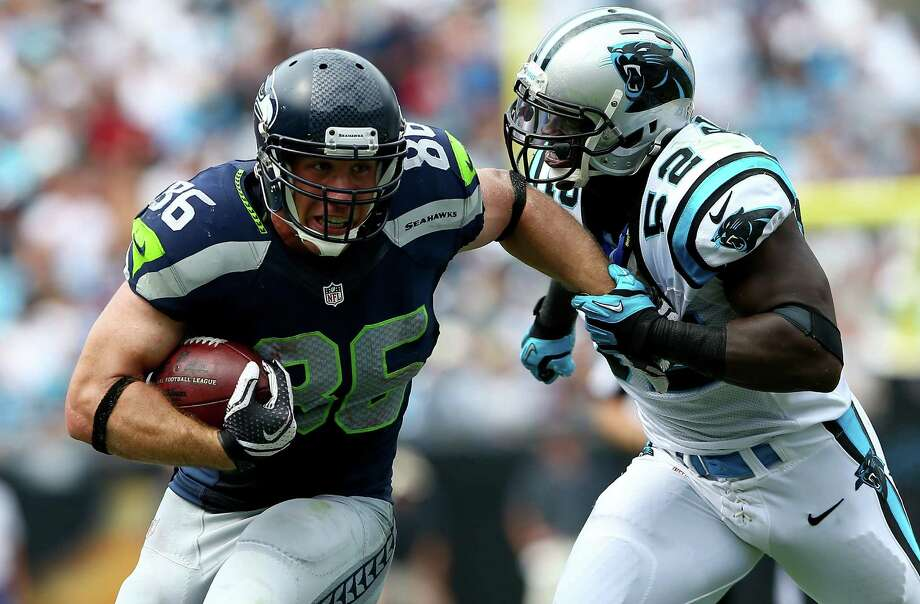CHARLOTTE, NC - SEPTEMBER 08:  Zach Miller #86 of the Seattle Seahawks runs with the ball as Jon Beason #52 of the Carolina Panthers tries to make a tackle during their game at Bank of America Stadium on September 8, 2013 in Charlotte, North Carolina.  (Photo by Streeter Lecka/Getty Images) *** Local Caption *** Zach Miller; Jon Beason Photo: Streeter Lecka, Getty Images / 2013 Getty Images