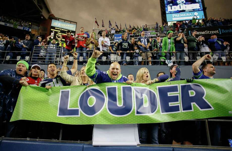 SEATTLE, WA - SEPTEMBER 15:  Fans cheer during the game between the Seattle Seahawks and the San Francisco 49ers at CenturyLink Field on September 15, 2013 in Seattle, Washington. Photo: Otto Greule Jr, Getty Images / 2013 Getty Images