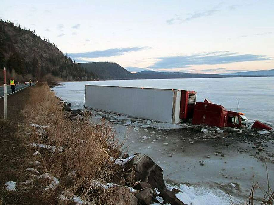Eighteen-wheeler goes skating on thin ice: This tractor-trailer ran off Highway 140 into Upper Klamath Lake 