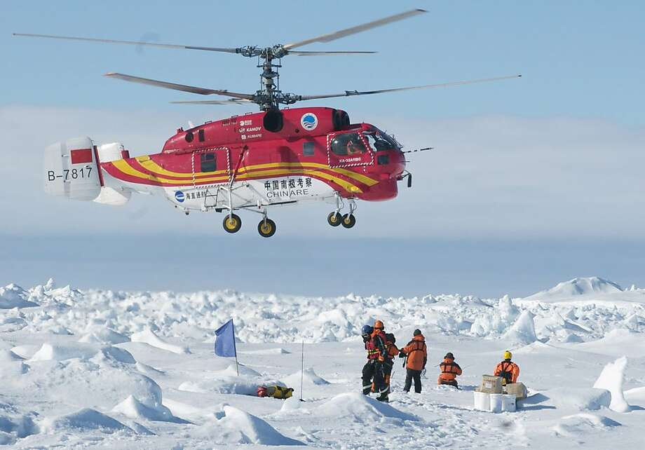 Antarctic rescue:A helicopter from the Chinese ship Xue Long carries passengers who spent Christmas and New Year's trapped on the icebound Russian 