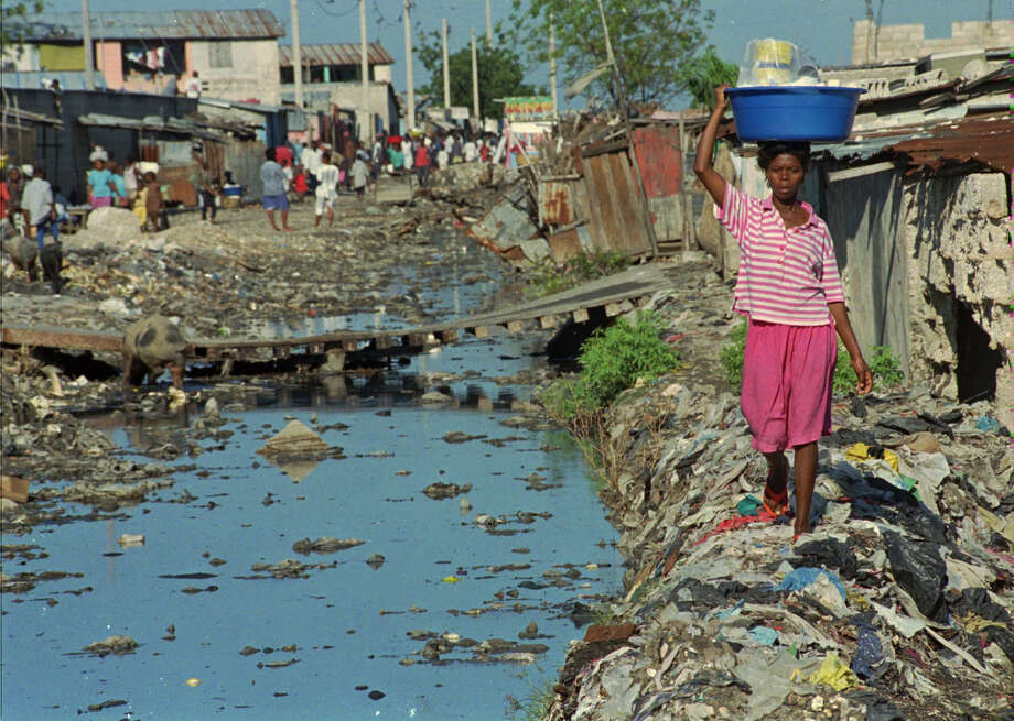 Public education and access to birth control in poor areas of Haiti,  including this slum in the capital, Port-au-Prince, would undercut the  nation's vast system of child trafficking. Photo: Associated Press / AP