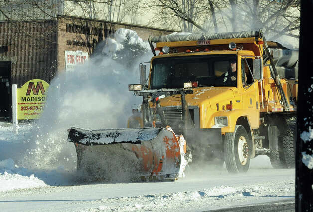 A Milford plow truck makes its way along Anderson Avenue in Milford, Conn. on Friday January 3, 2014. Photo: Christian Abraham / Connecticut Post