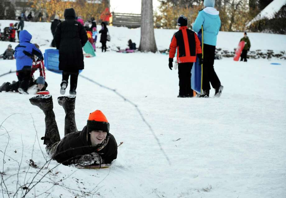 The bitter cold temperatures did not stop New Canaanites from bringing their kids to snowboard at Waveny Park Friday afternoon. The storm dumped about 6 inches of snow in New Canaan, according to the National Weather Service. Photo: Nelson Oliveira / New Canaan News