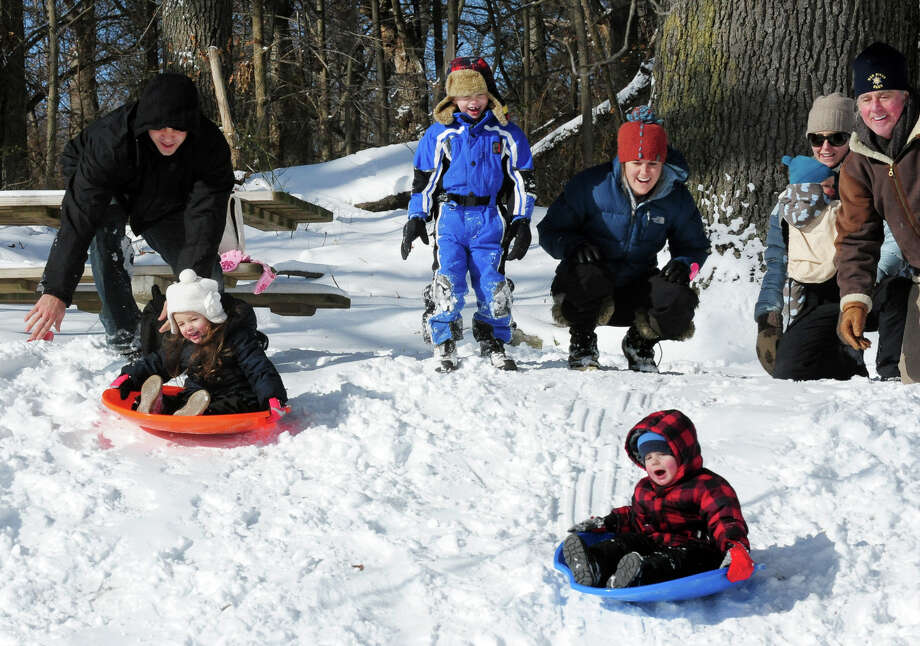 Families sled on the hill at Gould Manor Park in Fairfield, Conn. on Friday January 3, 2014. Photo: Christian Abraham / Connecticut Post